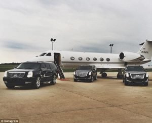 Cadillac SUVs and a private jet